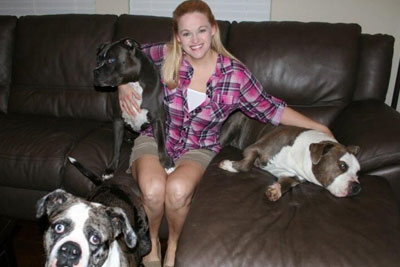 Tiffany Jolley and her three, lovable pit bulls.